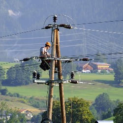 Clam Gulch AK electrician on power line pole