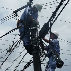 Dutch Harbor AK electricians working on power lines